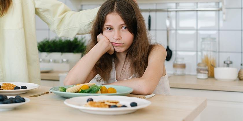 pexels-mikhail-nilov-child-food
